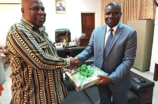 Nigerian High Commissioner to Ghana Ambassador Olufemi Michael Abikoye (right ) presenting a gift to Greater Accra Minister, Mr. Ishmael Ashitey
