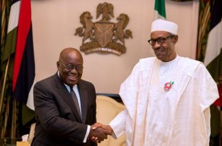 President Muhammadu Buhari of Nigeria (right ) in handshake with President Nana Akufo-Addo of Ghana