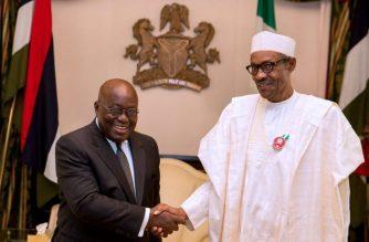 President Muhammadu Buhari of Nigeria (right ) in handshake with President Nana Akufo-Addo of Ghana