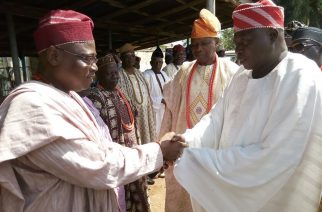Olomu in handshake with the Eesa, Omu-Aran, High Chief Jide Adebayo