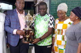 Nigerian High Commissioner to Ghana, Ambassador Olufemi Micheal Abikoye, (second left) receives AWCON  trophy from  an official of NFF,  while his spouse, Kikelomo (second right) and Hon. Ayo Omidiran watch at a  dinner hosted by the Ambassador  for the Super Falcons in Ghana