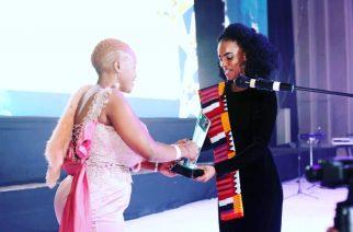 Gonaya receiving an Award